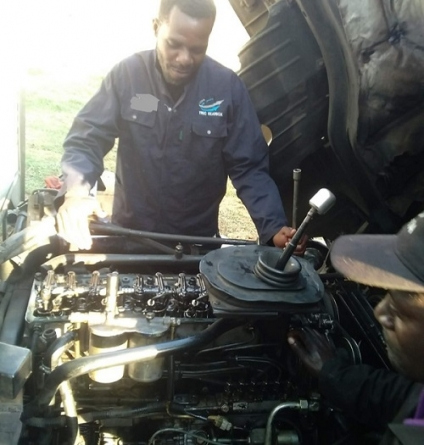 Kapini trades his gloves for spanners