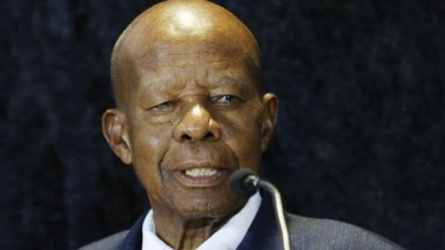 Masire tributes pour during emotional burial
