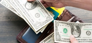 ECONOMIC VIEW:  Can you save money while repaying debt?